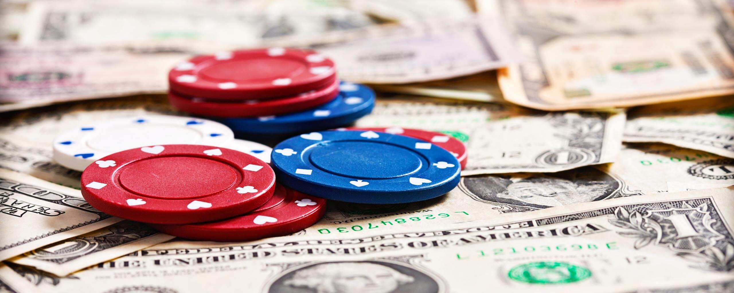 Gambling chips on dollar banknotes
